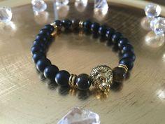 Men's Handmade Black Matte Tiger Eye Bead Bracelet, 8mm Gold Plated Lion Head #Handmade #Beaded Mens fashion 8mm handmade beaded #bracelets, #Stretch Bracelet, Fashion bead #Bracelet. Men's beaded bracelet, women's beaded bracelet #guys #stuff #mens stuff, men's #accessories, beaded #jewelry, bead bracelet #luxury #goals, luxury, wrist wear, luxury fashion, #trendy, hipster bracelet, Stretchy bracelet, BoHo Bracelet.
