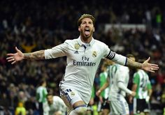 Real Madrid's defender Sergio Ramos celebrates after scoring a goal during the Spanish league footbal match Real Madrid CF vs Real Betis at the Santiago Bernabeu stadium in Madrid on March 12, 2017. / AFP PHOTO / GERARD JULIEN
