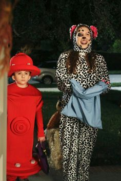 Halloween ~ Sue is a Dalmatian dog and poor Brick is the fire hydrant