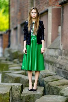 Long flowing green vinyl skirt that falls below the knee.  Combined with matching white and green shirt, black leather jacket, and black heels.. DIY the look yourself: http://mjtrends.com/pins.php?name=green-vinyl-fabric
