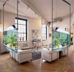 """Today there is a reinvention to the very idea of installing aquariums. Dubbed as ASP Spacearium fish tank, it aims to ""revamp your indoor space,"" against being a masterpiece or hanging accessory with some fish in it residing at any corner."""