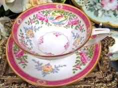 MINTONS TEA CUP AND SAUCER PINK WITH BIRDS PATTERN TEACUP