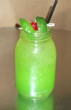 Toby Keith's Swamp Water.          (prepare in mason jar over ice)  1.25 ounces – Wild Shot Silver 2.25 ounces – Apple Pucker .75 ounces – Simple Syrup Splash of Midori Fill with Sweet  Sour Mix. Float lime juice, garnish with 2 limes and a cherry. Add 2 drops of green food coloring to darken the green (optional)