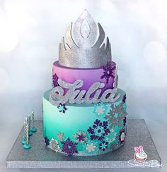 Purple, turquoise and silver Frozen themed cake, with Elsa tiara and glitter snowlflakes - SmartieBox Cake Studio