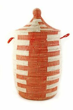 "African Prayer Mat Laundry Hamper - Medium Red by Swahili Imports. $96.00. Made out of cattails and plastic strips. Dimensions: 14""D x 21-22""T. Fair Trade product - We are a member of the Fair Trade Federation. Handmade in Senegal. African laundry hampers perfectly coalesce function with style. Our Wolof prayer mat hamper and baskets are incredibly useful in the bedroom, laundry or any other space in need of a decorative storage solution. Wolof women in rural Senegal have been cr..."