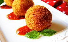 Salvatore Cuomo: Arancini Di Riso ( Risotto Croquettes)  I would need to make this gluten free, aside from that I'm hungry looking at this.