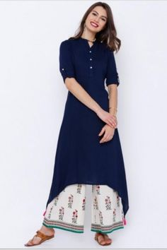 Buy Vishudh Navy Blue Solid A-Line Kurta online in India at best price.avy blue A-line kurta , has a mandarin collar, short button placket, three-quarter sleeves with roll-up Simple Kurti Designs, Stylish Dress Designs, Kurta Designs Women, Dress Neck Designs, Stylish Dresses, Salwar Designs, Blouse Designs, Pakistani Dress Design, Pakistani Dresses