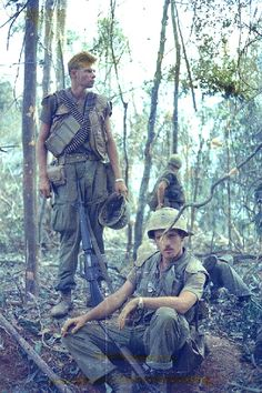 Two US Marines during Operation Scotland II. The one seated is a lieutenant and artillery forward observer.