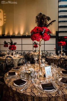 red rose centre piece with black feathers