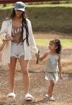 Bonding time: Kim Kardashian was seen with daughter North West after a helicopter ride in Costa Rica on Saturday