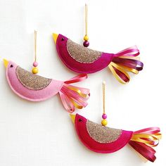 Three pink bird decorations made from wool felt and tweed, with mixed ribbon tails and glass bead eyes. Hanging threads with wooden beads. These little birds make perfect Spring decorations either grouped on a twig or spread around the house, and they. Felt Christmas Ornaments, Christmas Decorations, Bird Decorations, Spring Decorations, Bird Ornaments Diy, Fabric Ornaments, Christmas Tree, Felt Crafts, Fabric Crafts
