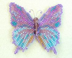 Create a stunning Amethyst Hairstreak Butterfly using this 7 page beading pattern and tutorial in pdf format that includes text, photos and