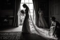Bride silhouetted in her wedding dress