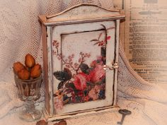 Key hanger cabinet box . Decoupage Hanging Wooden rack / Handmade House decor Shabby chic 100 years old upcycled Rustic. $65.00, via Etsy.