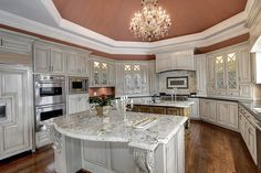 High End Kitchen with Coral Ceiling