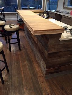 Caribbean Heart Pine from SYP Direct. The bar is unfinished, but our floors look amazing. Create your dream floor at 1/3 the cost of prefinished flooring.