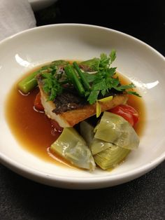 Branzino with Artichokes, Tiny Tomatoes, Asparagus and Bouillabaisse Broth, Herb Salad