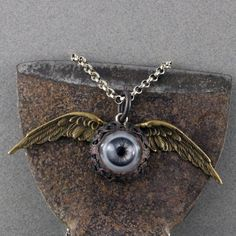 Handmade Flying Eye Necklace by oscarcrow on Etsy, $38.00