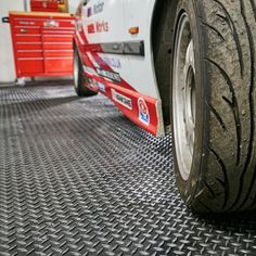 Heavy-duty PVC 50cm floor tiles with gripped diamond / checker plate surface. Transform your garage or workspace!