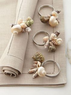 You can always dress up a plain napkin with a cute napkin ring! Shiraleah Sea Shell Napkin Rings, Set of 4 Napkin rings made of sea shells and stainless steel. each, x Imported. Tablecloths, Table Runners & Cocktail Napkins at Neiman Marcus Horchow Fine T Seashell Crafts, Beach Crafts, Diy And Crafts, Arts And Crafts, Diy Rings, Diy Napkin Rings, Rustic Napkin Rings, Beaded Napkin Rings, Shell Art