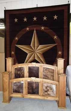 Huge Texas Star Rug & Cowhide Bed by Wild Bills Furniture Store, via Flickr