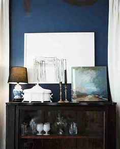 Interior Design by Ashley Putnam.  Note the bold blue on the wall =)