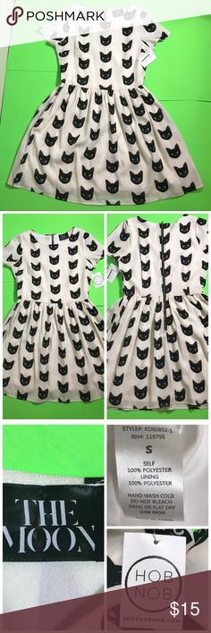 """Cat Dress by The Moon Cute black cat dress with cats printed throughout. It's a great fall dress especially for October. Pair it with some mary jane heels or Docs to bring some edge to your look. Total Length:35"""" Across chest:17"""" Waist:14"""" bottomhalf:18"""". Has lining underneath. Colors:Cream and Black/ Material: 100%Polyester/ fits like Size:2 It has a small hole at bottom refer to image. Never worn out. Still with tags. The Moon Dresses Midi"""