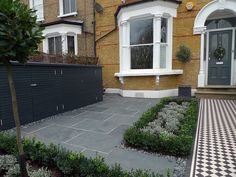 Front garden Victorian Tile topairy bike bin store mosaic black and white wall West London Putney Sheen Richmond Ham London   London Garden Design