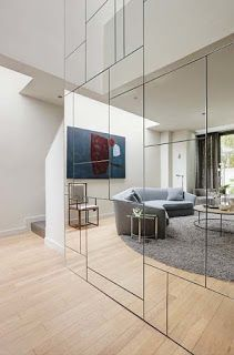 A geometric mirrored wall conceals closets and storage spaces which are located behind the touch latch mirrored doors. - Serene Notting Hill Studio House ... & WARDROBE 01 from \