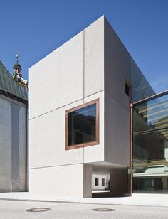 A concrete and glass extension to a school at a former monastery in Rattenberg, Tyrol.