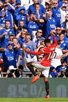 Manchester United's English midfielder Jesse Lingard celebrates scoring the opening goal during the FA Community Shield football match…