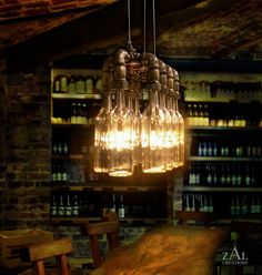 Wine / Beer bottles Suspension Lamp Pendant Light by ZALcreations, Pipe Lighting, Pendant Lighting, Beer Shop, Plumbing Pipe Furniture, Wine And Beer, Pendant Lamp, Clear Glass, Light Fixtures, Decoration
