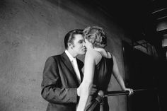 """""""The Kiss,"""" Elvis Presley - the Mosque Theater, June 30, 1956. Though perhaps Wertheimer's most iconic photograph, the identity of the woman remained unknown until she came forward in 2011, 55 years after the photo was taken © Alfred Wertheimer"""