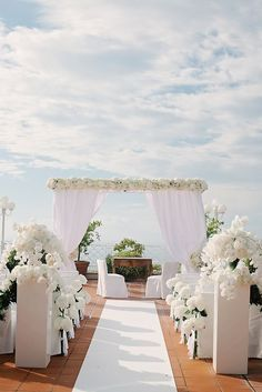 All white wedding ceremony setting for an outdoor, formal wedding #aromabotanical
