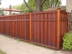 Shadow box fence in stained cedar with offset rail