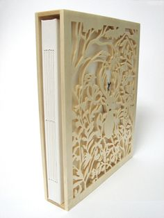 Naomi Shiek's papercut book Deer Myths.  The book was handmade and hand bound. The packaging was beautifully cut by a carpenter artist.   Naomi Shiek / Woodland Papercuts @2010