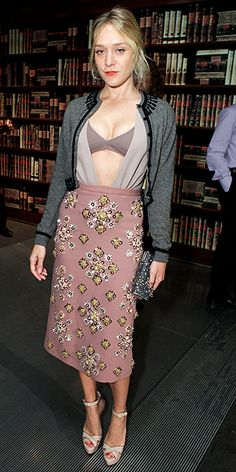 Chloe Sevigny - Miu Miu   Er... your bra is showing.