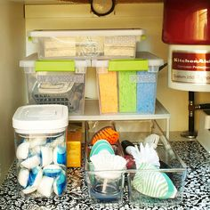 Maximize your space under your sink with labeled containers for easy organization: http://www.bhg.com/decorating/storage/projects/cabinet-and-undersink-storage-solutions/?socsrc=bhgpin02062014inthekitchen&page=9