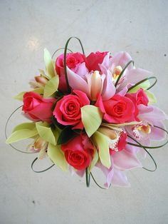 Coral Roses, Lavender Cymbidium Orchids and Bear Grass Loops