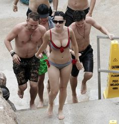 Pin for Later: See Katy Perry in Various States of Undress  Katy hit the beach in the Bahamas in July 2010 wearing a bikini with red ties.