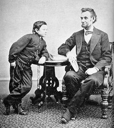 "Thomas ""Tad"" Lincoln poses on April 10, 1865 with his father President Lincoln in the Whitehouse.  Tad outlived his father, but died of heart failure at the age of 18 on July 15, 1871."