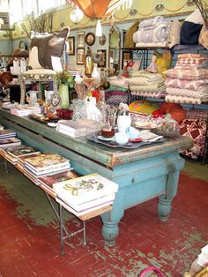 nest * san francisco...love this display idea for OVT...<3 <3 <3 THAT TABLE!!