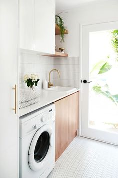 MY LAUNDRY RENOVATION REVEALED — Adore Home Magazine Love the white and wood combo, just white cabinets would be too white. The full light door makes the room sunny and cheerful. Modern Laundry Rooms, Laundry In Bathroom, Laundry Room Small, Laundry In Kitchen, Small Utility Room, Laundry Cupboard, White Laundry Rooms, Laundry Decor, Laundry Room Cabinets