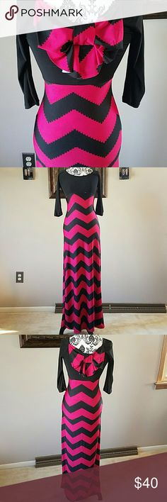 "STRIKING BOW BACK MAXI A gorgeous bold chevron pattern and bow tie accent maxi with demure detail. Drapes beautifully with a curve skimming fit.  - Round neck line with 3/4 sleeve. - 92% polyester and 8% spandex bring all day comfort - Made in USA - 55"" long from high point of shoulder to bottom hem Dresses Maxi"