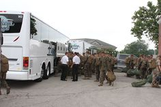 Drivers, Tom Clark and Ken Untrauer helping our men in uniform as they board our Hawkeye Stages motorcoaches.