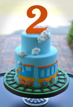Little train cake with puffy clouds.