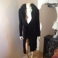 Black Sweater with Fur Collar Long black sweater with faux fur around neck. Buttons & sash tie. Excellent condition. No trades Chesley Sweaters