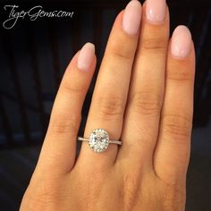 """So in love with this ring! It's absolutely beautiful and so sparkly when the light hits it. Highly recommend TigerGems!""  Thank you so much to my client for this review and photo of her 1.5 ctw oval halo ring. ━━  Shop Now at TigerGems.com"