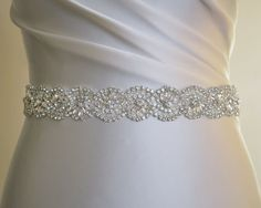 All around beaded belt, quality belt for a bride, bridesmaids or your special occasion dress. Belts are stitched on ribbon, closes with