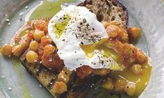 Yotam Ottolenghi's slow-cooked chickpeas on toast with poached egg: 'Comfort food.' Photograph: Colin Campbell for the Guardian. Food stylin...
